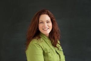 Jennifer Myers - green jacket - dark background - small